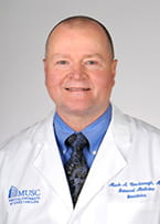 Mark A. Newbrough, M.D.