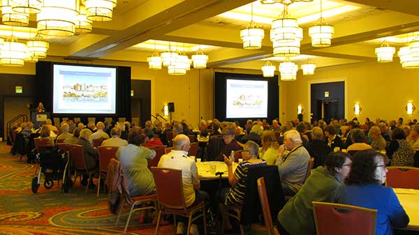 Symposium attendees listening to Dr. Hinson's presentation