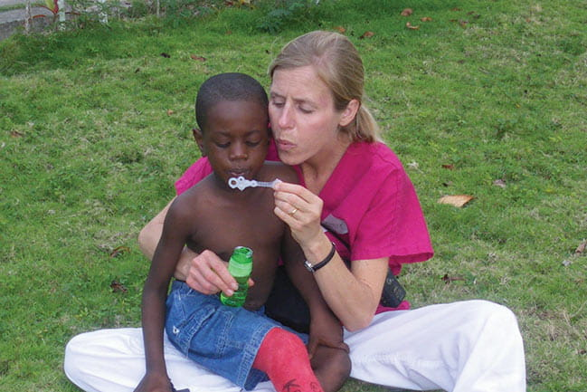 Photograph of Lindsey Demos, PT, wife of Dr. Harry Demos, coordinates MUSC trips to Haiti and provides hands-on caring to patients