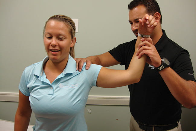 Photograph of physical therapist Mike Barr with patient