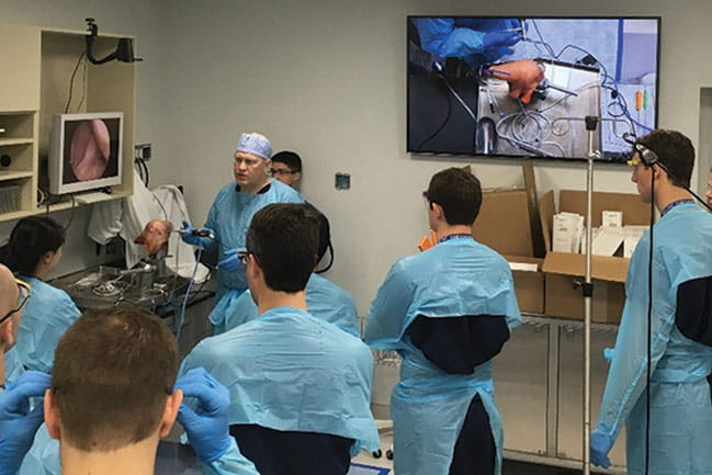 Photograph of Dr. Woolf leading a training session for MUSC orthopaedic residents.