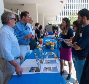 MPH students talk to people at public health week booths