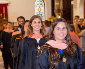 Happy graduates leave their M.P.H. Hooding ceremony
