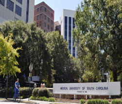 Picture of MUSC campus with green spring trees with MUSC Campus Sign