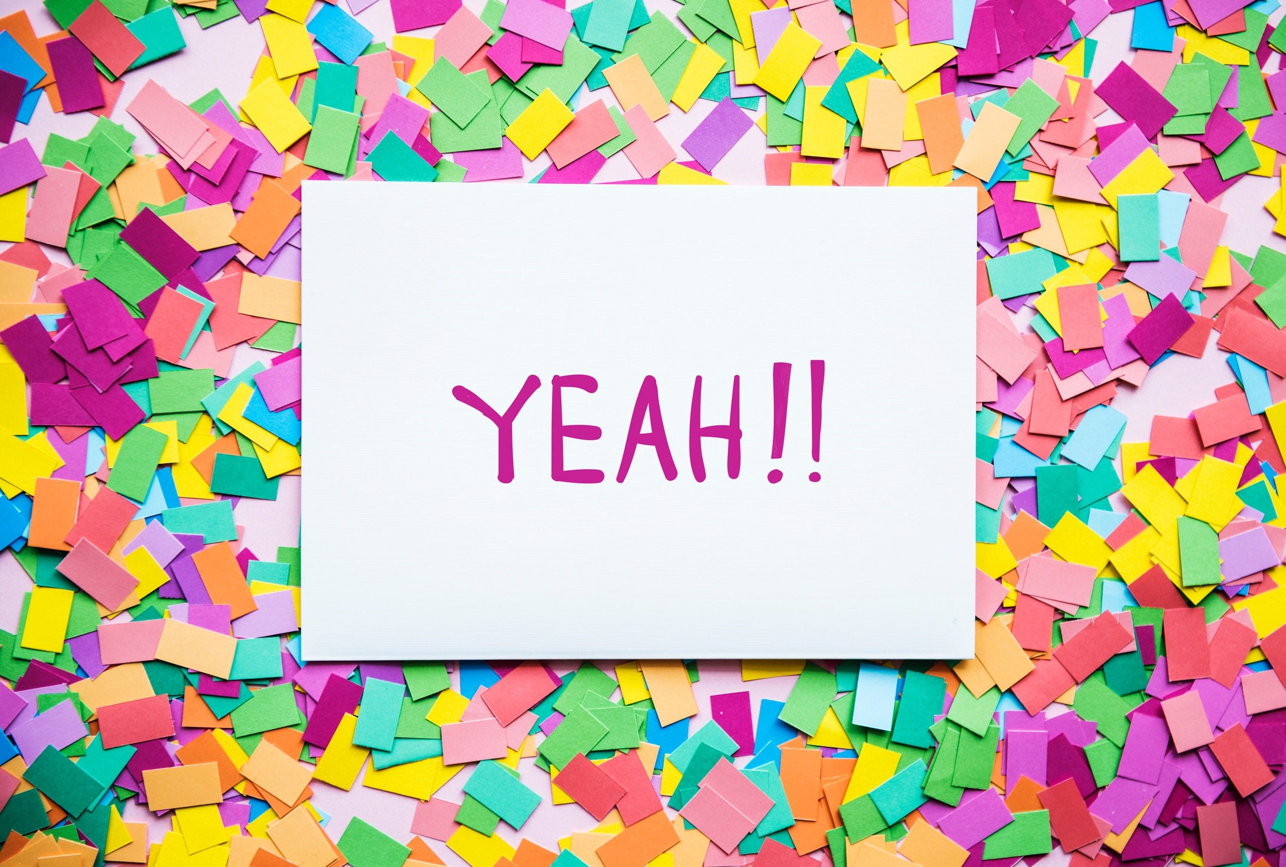 Confetti with paper that says Yeah!!