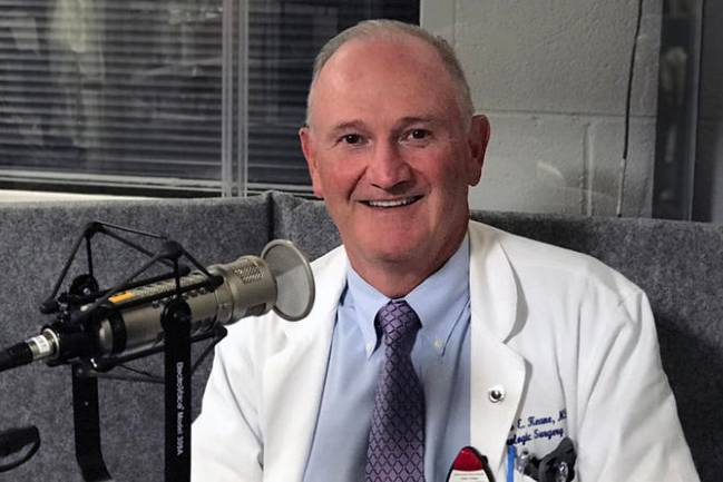 Dr. Thomas Keane at the microphone recording his Health Focus podcast.