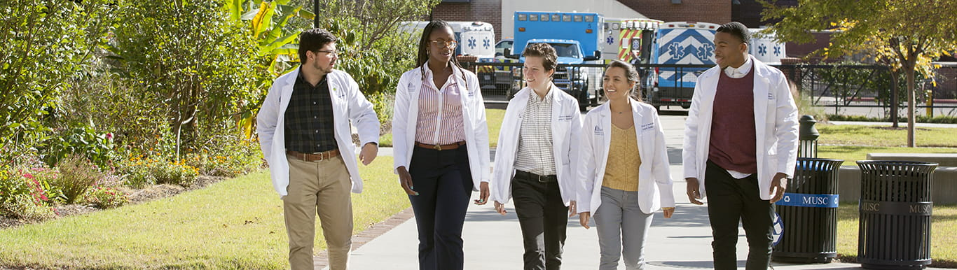 Five College of Medicine students walking the campus.